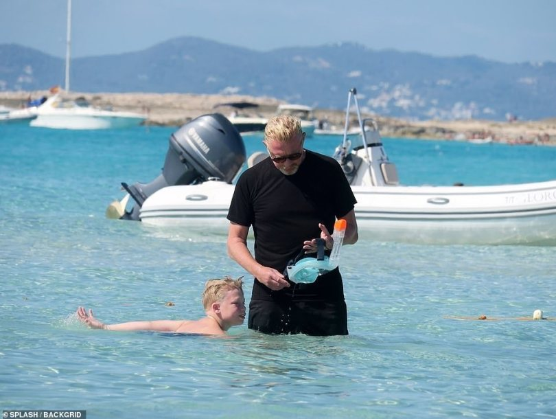 Doting dad: Boris helped fix his son's snorkel so he could take a look at the sealife