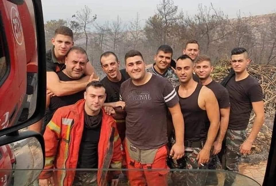 Hero Methal Hawwa, front left, is seen here posing with fellow firefighters in this group photograph