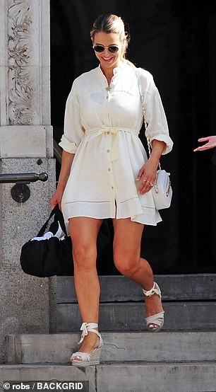 A beauty: She teamed the dress with chic nude wedges and a white Chanel handbag