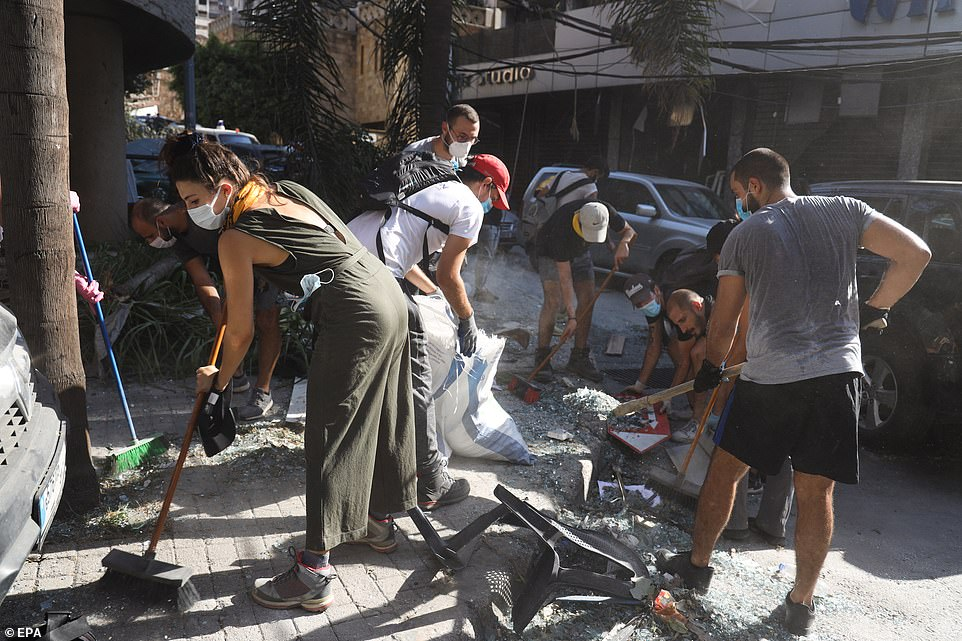 An army of volunteers have taken to the streets to sweep up glass, clear away rubble, rehouse the homeless and repair buildings amid a near-total absence of state support