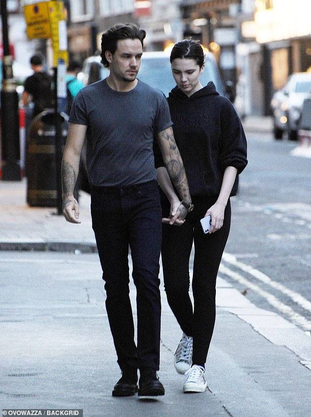 Out: Liam Payne, 26, and his girlfriend Maya Henry, 20, looked struck as they held hands as they walked through London on Wednesday