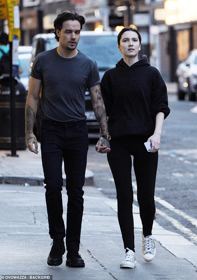 Relaxed: Maya kept things casual for their date by pairing a simple black hoodie with a pair of tight leggings that showcased her slender legs