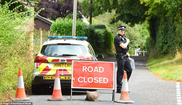 Armed officers swooped on idyllic Upper Enham, Hants, yesterday afternoon after the attack which police said left a 42-year-old man with serious injuries. Pictured: Police at the scene of the shooting in MacCallum Road, Upper Enham, today