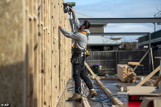 Property developers have slammed the Victorian government's decision to restrict work on construction sites to 25 per cent of normal capacity. Pictured is a Melbourne working on his own on Thursday