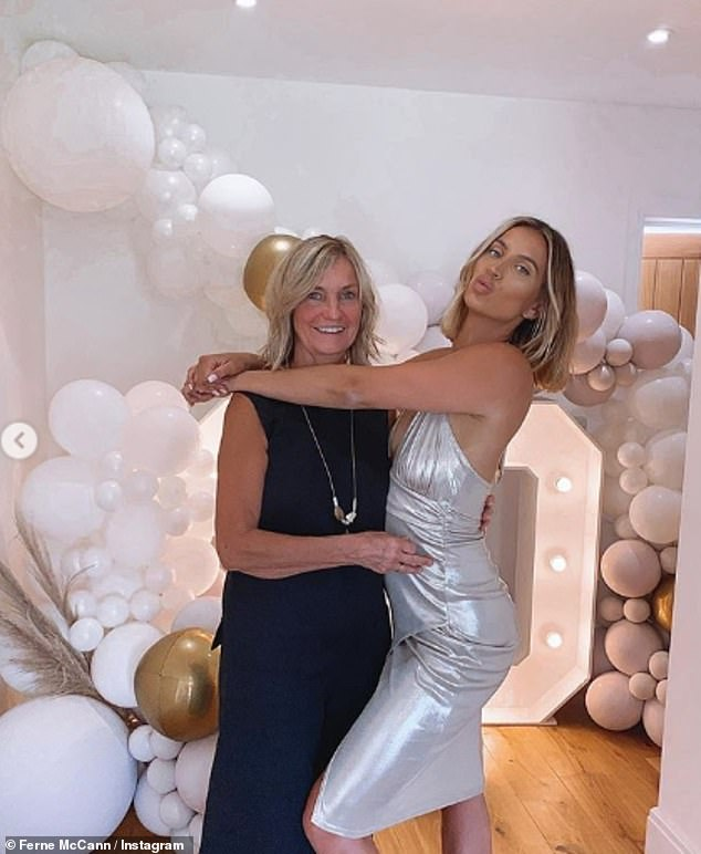 Glam gals:In another snap she posed up a storm and pouted as she hugged her beloved mum Gilly