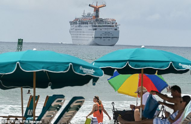 Pictured, The Grand Celebration cruise ship owned byBahamas Paradise Cruise Line. The ship has been stationed in Florida with staff allegedly trapped onboard since March