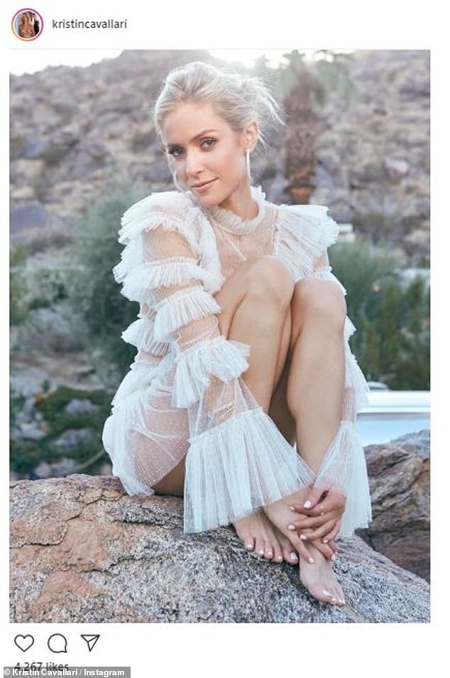 A thing for white: In July the leggy lady also posed in white, this time a lace top