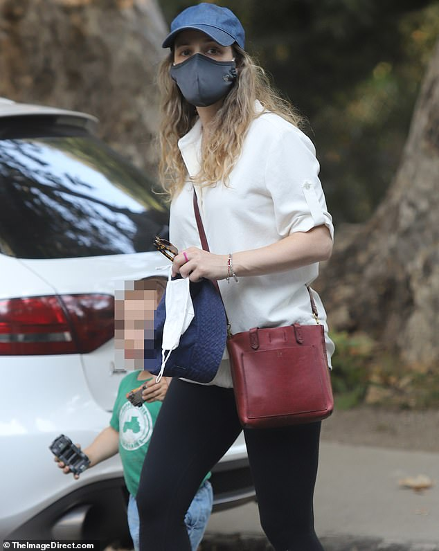 Careful:The 41-year-old Mean Girls icon made sure to keep her mask on while she stepped out amid the coronavirus pandemic
