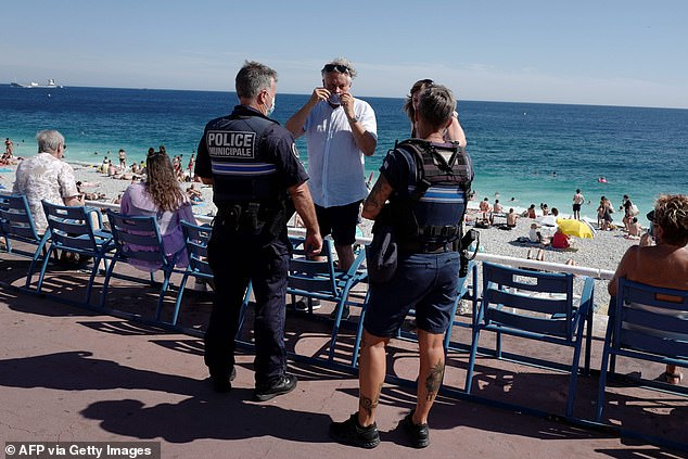 Police tell people it is mandatory to wear face masks in Nice, France on Monday