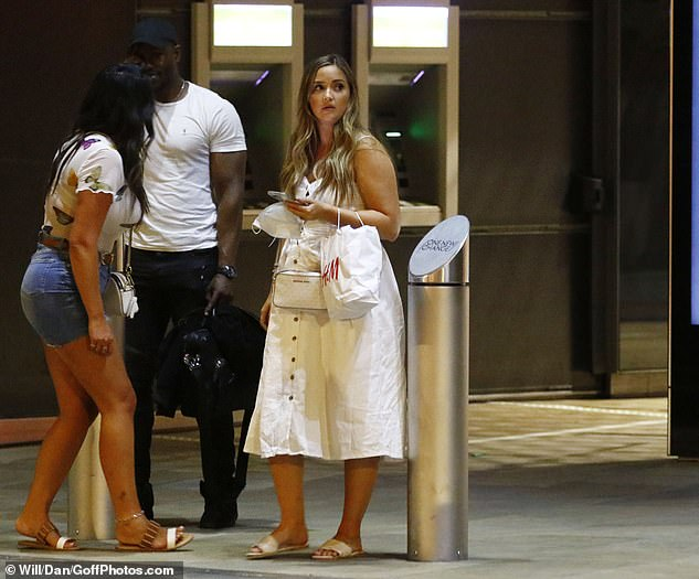 Chilling: Jacqueline and her pals appeared to be waiting for a taxi back to Essex