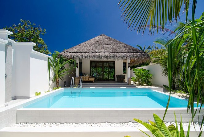 Private villas are constructed with natural thatch roofs and light and unassuming exteriors that blend in with nature