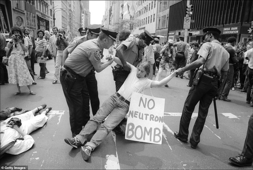 An anti-neutron bomb demonstrator is arrested for sitting in on 5th Ave on August 13, 1981