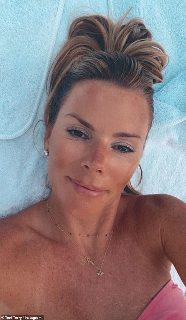 Stunner:The proud footballer, 39, shared a stunning snap of his bikini-clad wife, 38, while she also shared a selfie during their downtime