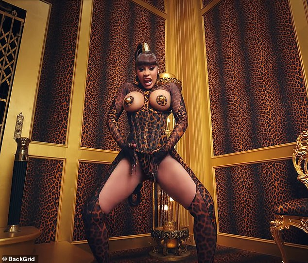 Eye-popping: Cardi  B stunned fans in this leather corset ensemble that showed off assets