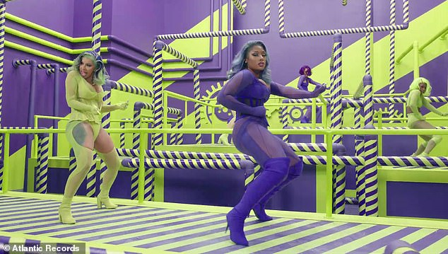 Dance break: There is swift transition from the snake pit to a blinding neon green and purple room, where Cardi and Megan feel compelled to put their best dance moves on display