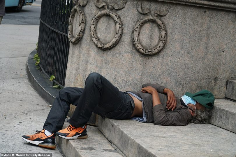 A man is seen passed out on the steps of First Baptist Church at 79th St and Broadway on Friday