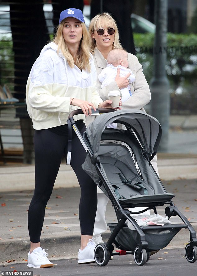 Family time! Jasmine Yarbrough enjoys a stroll with daughter Harper May and lookalike sister Jade
