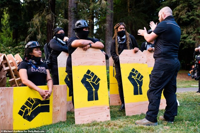 Protest leaders instructed those carrying shields on how to behave and position themselves