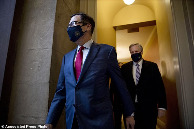 Treasury Secretary Steven Mnuchin (left) and White House Chief of Staff Mark Meadows (right) walk to speak to reporters after Friday meeting with House Speaker Nancy Pelosi and Senate Minority Leader Sen. Chuck Schumer as they continue to negotiate a coronavirus relief deal