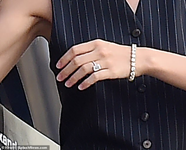 Glam: The American actress made sure all eyes were on her ring, keeping her other accessories to a minimum