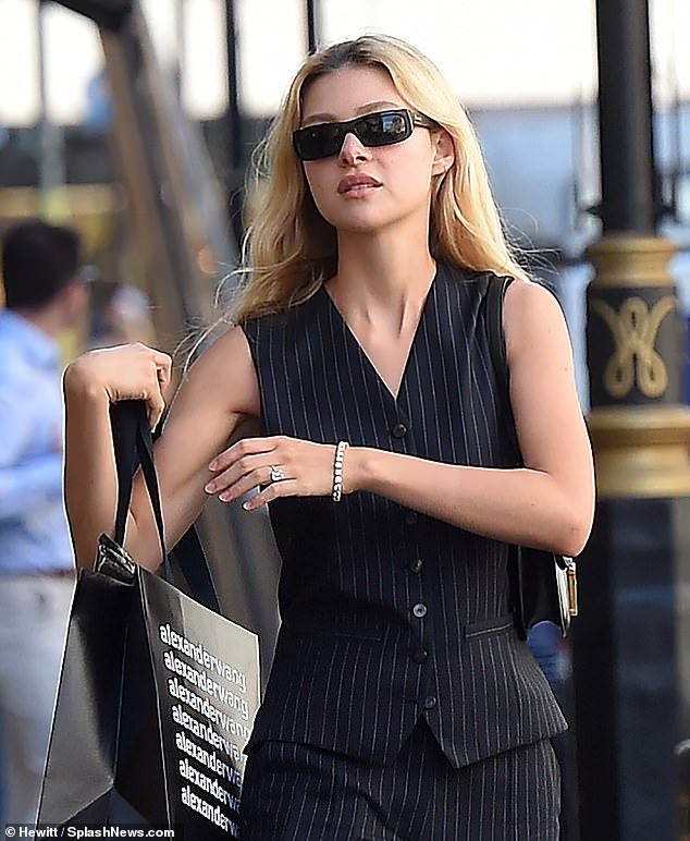 Style: Nicola exuded sophistication in a pinstripe cardigan and wide-leg pants