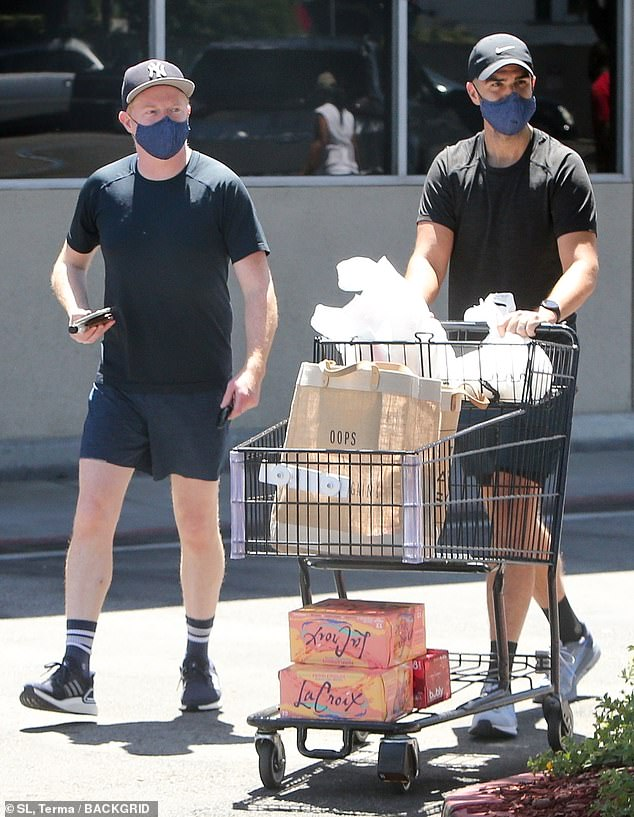 Grocery run: Jesse Tyler Ferguson and husband Justin Mikita, 34, were spotted stocking up on groceries for themselves and their growing baby in Los Feliz on Saturday afternoon