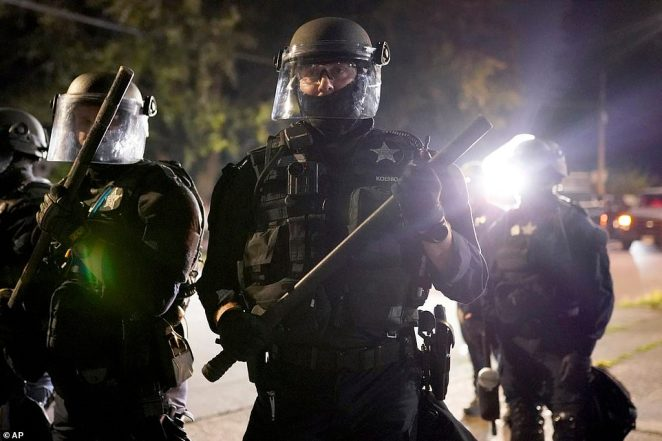 Police in Portland clashed with protesters on Friday night - the 72nd straight night of violence in the Oregon city