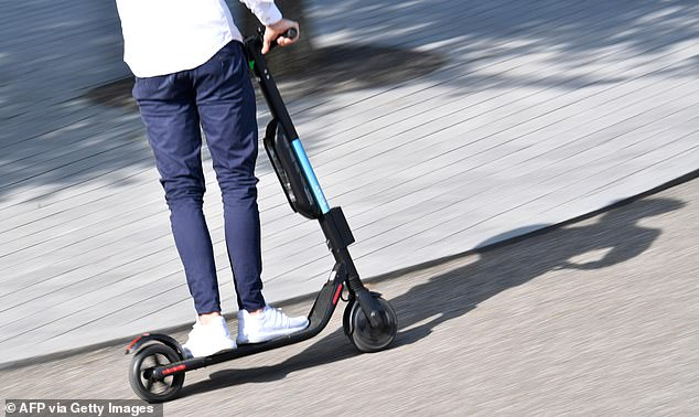 Car drivers are set to pay higher insurance premiums because of accidents caused by electric scooter riders, industry chiefs have warned (file photo)