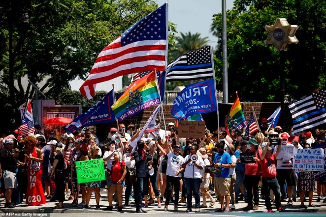As many as 400 pro-Trump Californian's met in West Hollywood on Saturday to protestproperty destruction and the 'villainization' of law enforcement amid a series of Black Lives Matter demonstrations