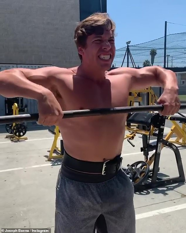 Mirror image: Joseph Baena, 22, looked much like his father, Arnold Schwarzenegger, when he hit the weights at an outdoor gym in Los Angeles on Saturday