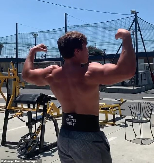 Strike a pose: Baena turned and flexed his biceps after he finished his set