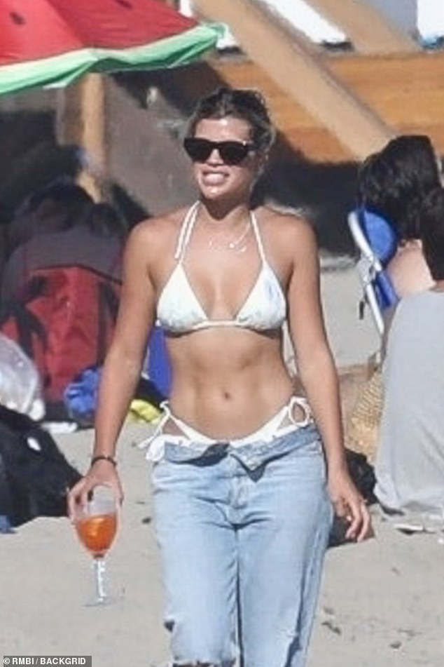 Sofia Richie shows off her abs and sips a glass of wine with friends during beach outing in Malibu