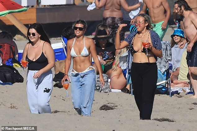 Girl group: Sofia was seen strolling along the beach with friends, laughing as they went along