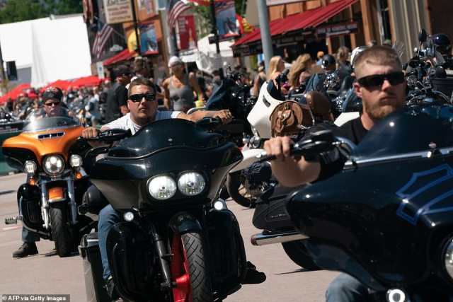 Motorbike riders are pictured flocking to Sturgis, South Dakota, on Saturday for a rally