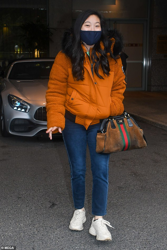 Off-duty: The American actress wore a protective face mask to limit the spread of coronavirus as she emerged for the low-key outing after isolating for two weeks following her arrival into the country