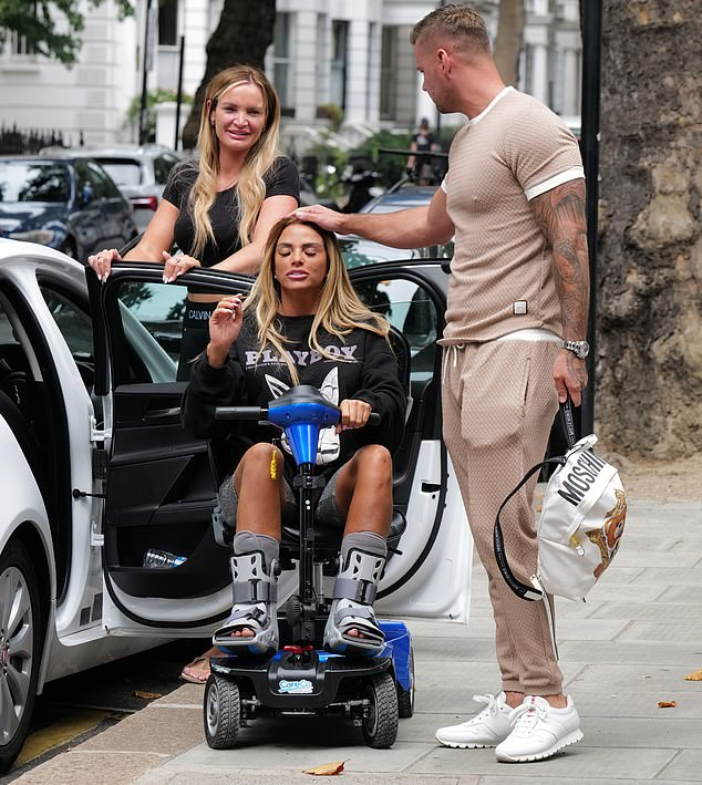 Hindered:The glamour model, 42, was wearing boots on both her feet and travelled on a scooter