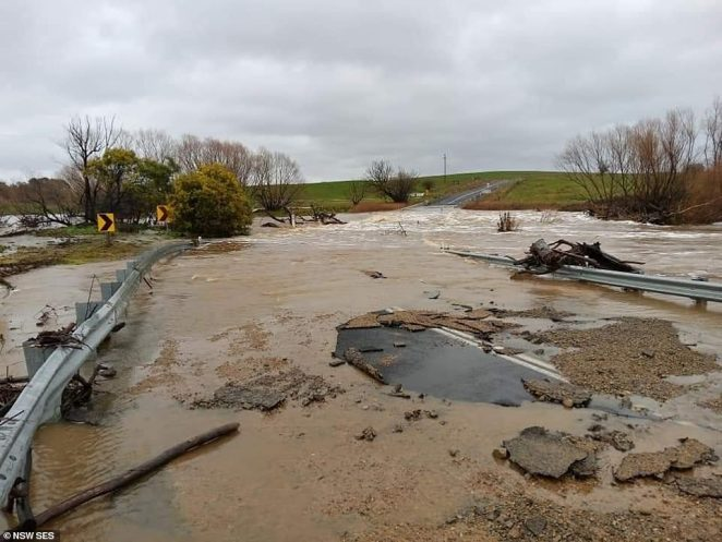 Roads were left damaged and covered in water and rubble when flash flooding subsided in parts of NSW