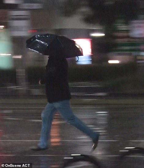 Man running in the rain