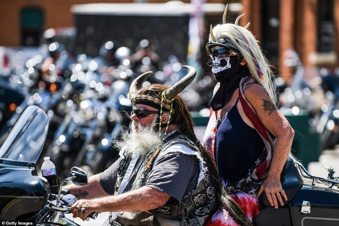 The annual event anticipated to attract 250,000 bikers kicked off Friday and guests have been seen without masks, as they're not required, and flouting social distancing guidelines as they pack in for concerts, at bars, and riding events