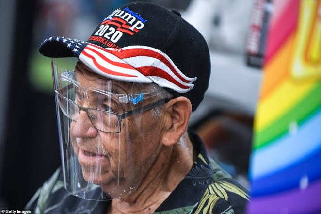 Trump supporter Gene Haheim pictured Friday selling face shields at the Annual Sturgis Motorcycle Rally