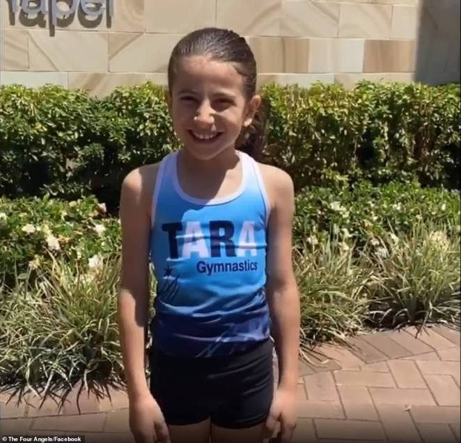 Further footage shows Sienna in her gymnastics outfit (pictured), cheering about attending a competition and fearlessly tumbling on the concrete - as well as plenty of videos singing her favourite songs