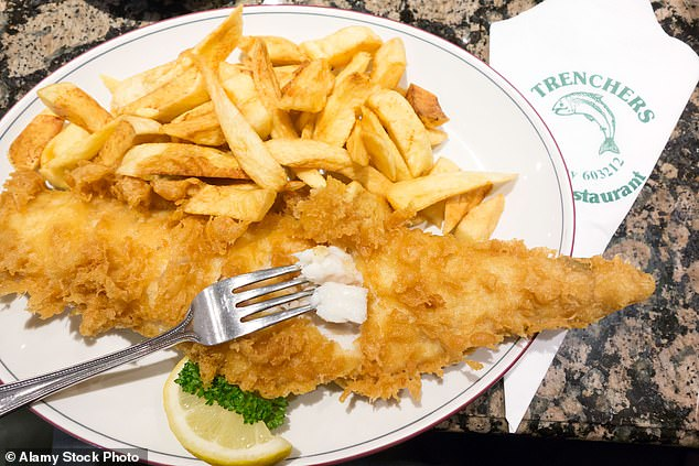 Families in the UK may have to change what fish they eat as study reveals cod may not keep up with the warming seas. PIctured: Stock photo of fish and chips