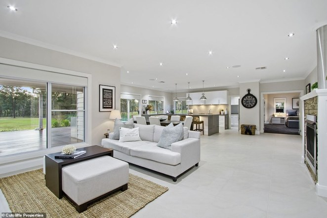 High ceilings feature throughout the property, with an open plan living and dining area extending out to the an expansive deck area