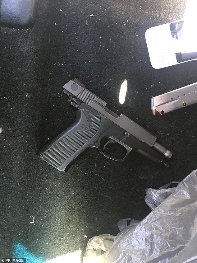 Detectives found a Smith & Wesson pistol, a Beretta pistol and ammunition (pictured), encrypted Blackberry devices and nearly $650,000 in cash
