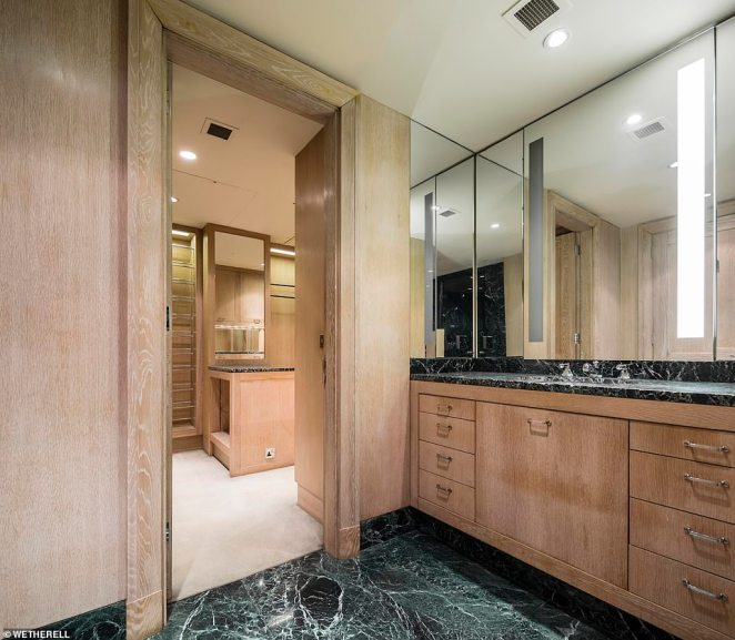 There is also a principal guest suite with a walk-in dressing room and ensuite bathroom. Pictured: the 'his' bathroom in the master suite