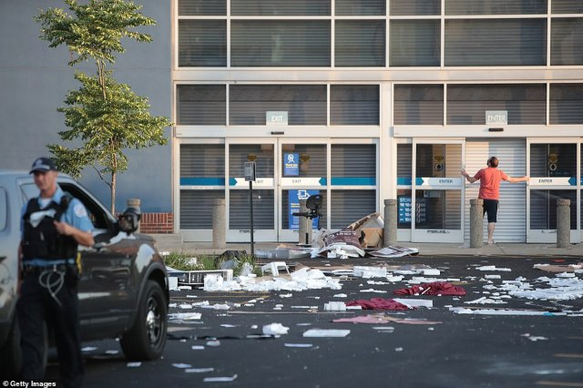 Debris lays in front of a damaged Best Buy store after parts of the city had widespread looting and vandalism, on August 10, 2020 in Chicago, Illinois