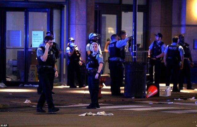Chicago police gather after rioting and looting occurred in the Gold Coast area of the city early in the morning of Monday, Aug. 10, 2020