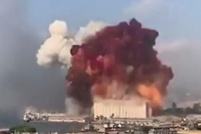 The devastating explosion last week. An Italian expert has claimed that the brick red cloud suggests that the blast was not caused by ammonium nitrate and suggested burning armaments had instead caused the blast