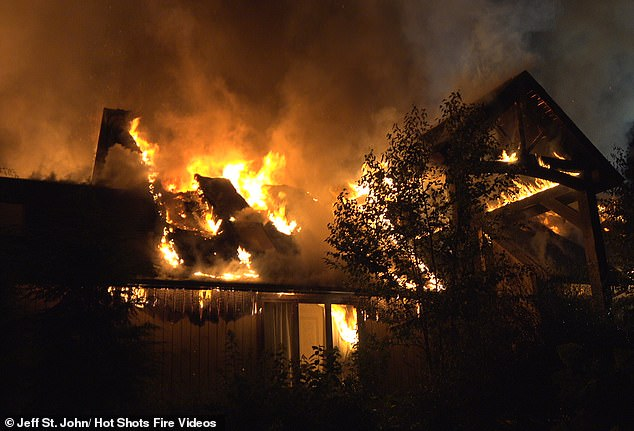 Flames: The couple had been living in the home 15 years when creosote spit out the top of their chimney and landed on the roof, which caused the catastrophic fire
