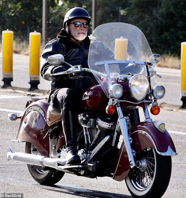 Proud grandfather: Arnold Schwarzenegger rides his motorbike while celebrating the arrival of his first grandchild